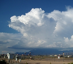 A dense cloud that grows upward, looks like a cauliflower, anvil, or tower, and usually has lightning, thunder, and rain.