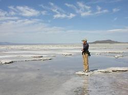 Gypsum Dreams: Shallow briny lagoon on the Great Salt Lake where salt deposits are accumulating. Courtesy & Copyright, David Roubik, Photographer
