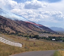 Investigating the Causes of Wildfires: A wildfire near Hyrum, UT, Courtesy & Copyright 2013 Holly Strand, Photographer