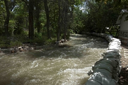 "Water-Liquid Life: Spring Runnoff in Cottonwood Creek near Sandbagged Home From ""Spring Run-off Dangers Ahead,"" Unified Fire Department Chief Mike Watson Courtesy Cottonwood Heights City"