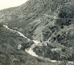 Logan Canyon about 1910. Four waterways: the aquaduct which was used for power generation, the canal, a water way that ran behind the building which had been part of the old Hercules Power Plant, and the Logan River. Photographer H.G. Hutteballe, Courtesy of Darrin Smith Photo Collection
