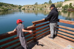 Logan Rivers evolving geomorphology: Logan River's Evolving Geomorphology: Father and son enjoying a day of fishing on the reservoir behind First dam in the mouth of Logan Canyon Courtesy & Copyright Shauna Leavitt, Photographer