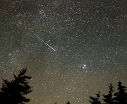 In this 30-second exposure, a meteor streaks across the sky during the annual Perseid meteor shower, Wednesday, Aug. 11, 2021, as seen from Spruce Knob, West Virginia. Courtesy NASA, Bill Ingalls, Photographer