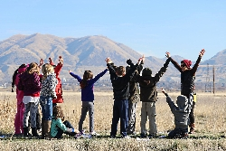 Isa and Students Imitating Raptor Flight Patterns at the Bear River Migratory Bird Refuge Courtesy & Copyright Edith Bowen Laboratory School(EBLS) Experiential Learning Eric Newel Director & Photographer