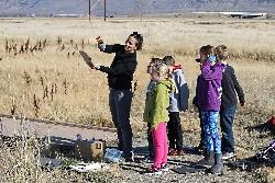 Lisa Saunderson teaching students to observe and ponder the landscape before rendering their horizons in watercolors at the Bear River Migratory Bird Refuge Courtesy & Copyright Edith Bowen Laboratory School(EBLS) Experiential Learning Eric Newel Director & Photographer